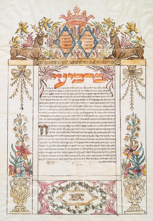 כתובה מגיברלטר, 1826, עם עיטורים וכמה סוגי אותיות. אותיות הכותרת עוצבו בסגנון שמנמן ומוארך, ונראה שהאותיות למטה הן אותיות בסגנון איטלקי רהוט או ספרדי רהוט (למרות שקשה לשפוט מכיוון שהתמונה קטנה).